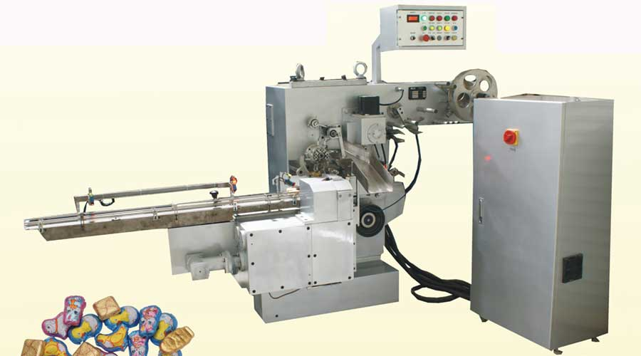 FOIL WRAPPING MACHINE FOR FLAT BOTTOM PRODUCTS